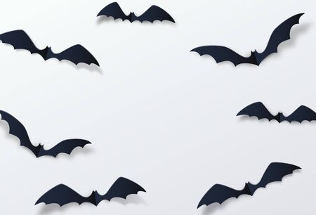 Halloween bat vector decor background. Paper cut style. Black vampire flittermouse flying over white backdrop. Copy space at the centre.