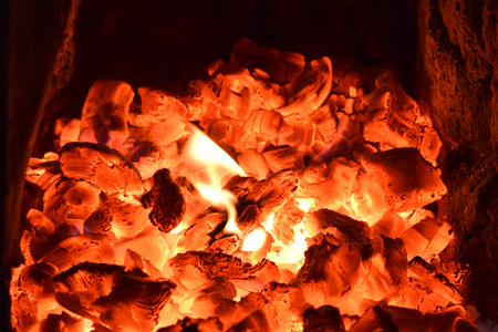 embers and flames in the small village kiln Stock Photo