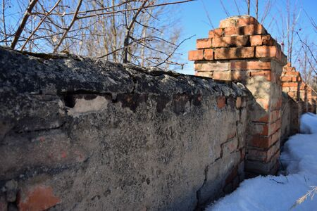 turrets: old brick wall with turrets which began collapses