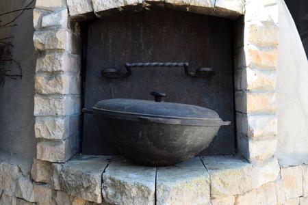 brick kiln: old steel bowl for cooking around the brick kiln