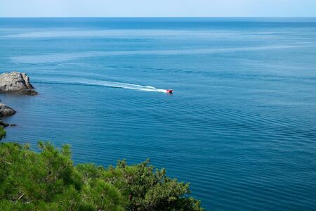 Pleasure boat rolls of people on the Blue bay Crimea, soft focus