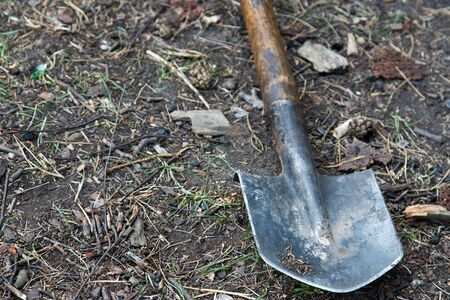 Shovel and dirt in an empty garden