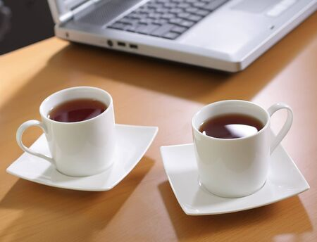 white cup tea at office