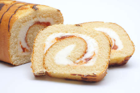 Swiss roll cake on white background