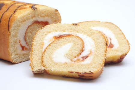 swiss roll: Swiss roll cake on white background