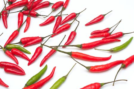 Mini  red and green hot chillies isolated on a white background