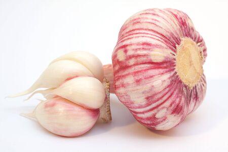 fresh garlics over a white background.