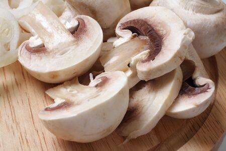 Field mushrooms on a wooden board