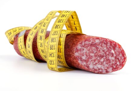 Sausage with a measuring tape, studio isolated Stock Photo