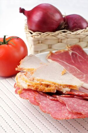 ham and salami, tomato and onions Stock Photo