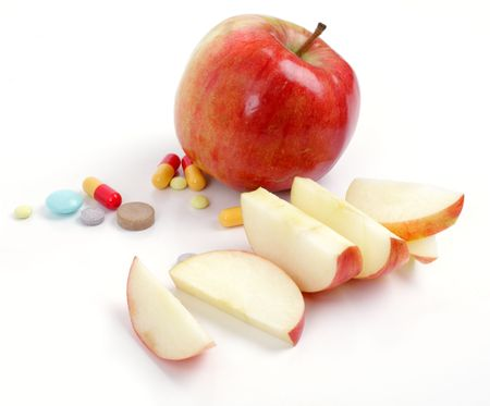 apple and medical tablets over white