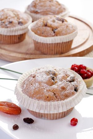 Some small round fruitcakes with raisin.  photo