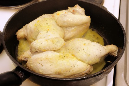 chicken fried in a pan