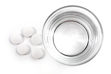 medical tablets and water glass