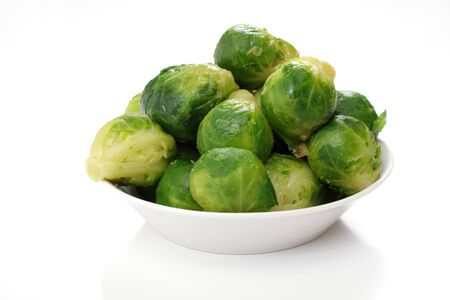roasted brussels sprouts on a white plate, studio isolated Stock Photo