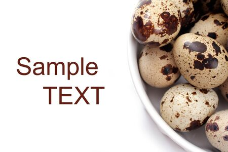 quail eggs in a white bowl on white background, studio isolated