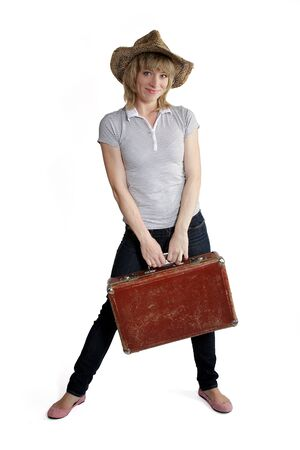girl in a straw hat and an old suitcase on white background
