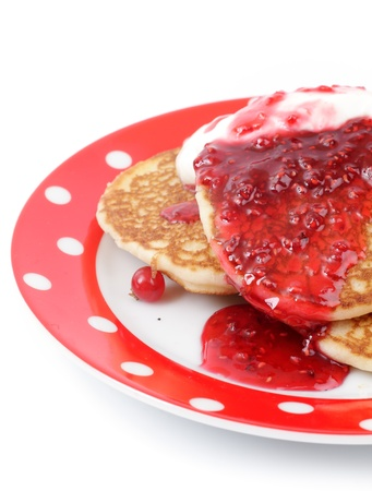 fritters with raspberry jam on a plate