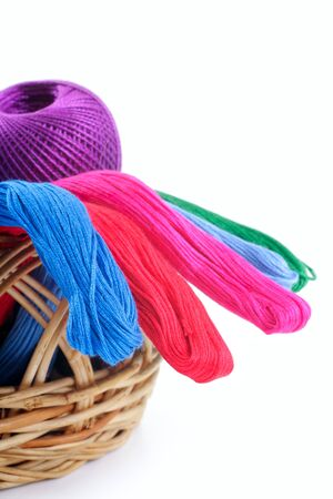 yarns of different colors for embroidery in the basket  Studio isolated  photo