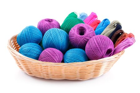 basket embroidery: yarns of different colors for embroidery in the basket  Studio isolated  Stock Photo