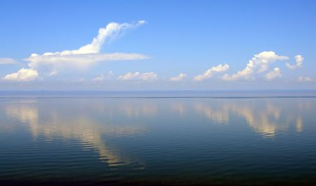 Reflection of clouds, lake Baikal photo