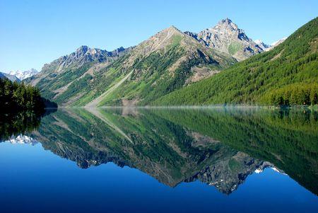 reflect: Mountain lake Kucherlinskoe, Altai, Russia Stock Photo