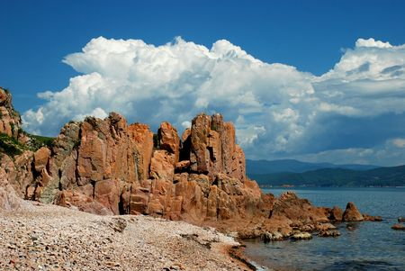 wrack: Red rock, coast of the Sea of Japan, Pacific ocean Stock Photo