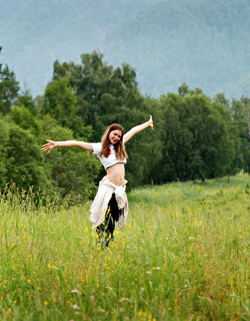 Happy young girl on meadow, Russia photo