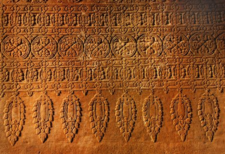 low relief: Old wall, stone ornament in antique Angkor Wat, Cambodia