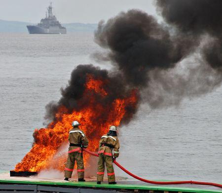 Firemen in fire, firefighting photo