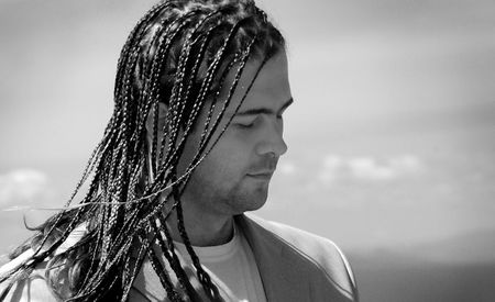 Young man with stylish hairdo - dreads Stock Photo
