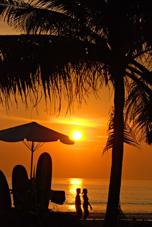 surfers: Sunset on Kuta beach, Bali, Indonesia Stock Photo