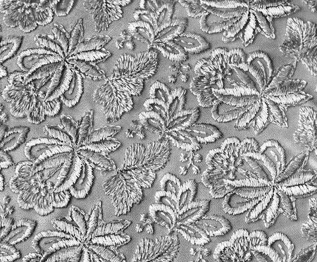 embroidered: Silver guipure, embroidery on cloth for wedding dress, texture Stock Photo