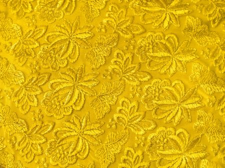 Yellow guipure, embroidery on cloth, texture photo