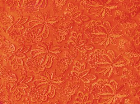 Orange guipure, embroidery on cloth, texture photo