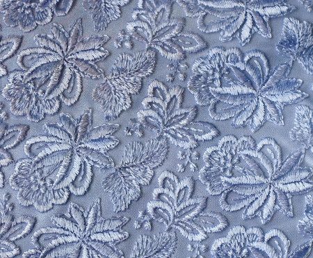 Blue guipure, embroidery on cloth for wedding dress, texture photo