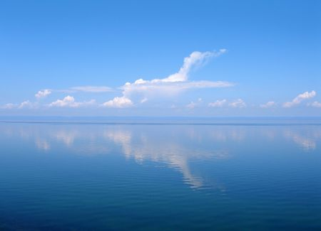 blue sky thinking: Cloud like plane, lake Baikal, Russia Stock Photo