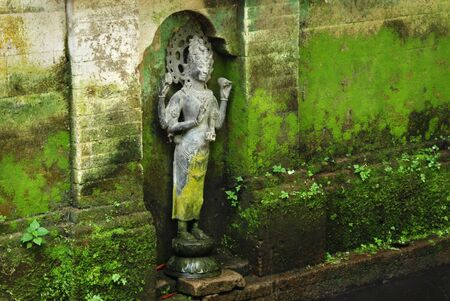 Stone wall fleeced with moss, antique monument, Bali, Indonesia photo