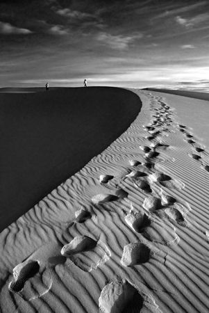Sand desert, walking couple photo