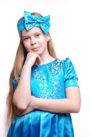 Beautiful young smiling girl child isolated on white, child with blond long hair, blue dress, studio photo