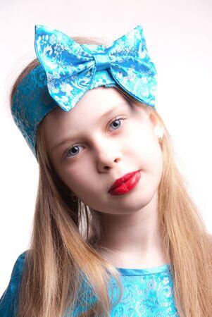Beautiful blonde girl  child, studio portrait isolated against white background photo