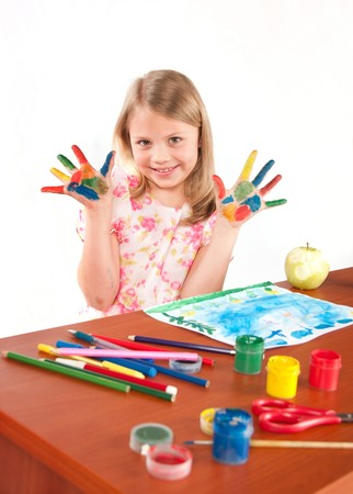 Smiling little girl drawing picture Stock Photo