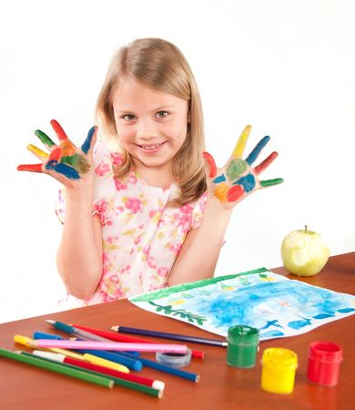 Smiling little girl drawing picture photo