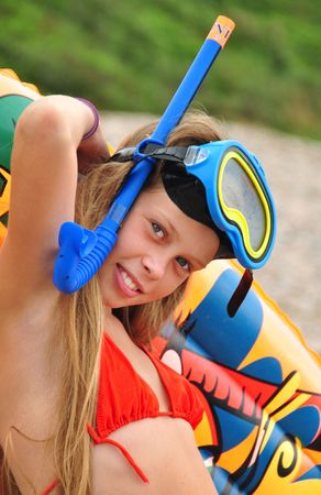 Beautiful young girl with snorkel, swimmer in vacation photo