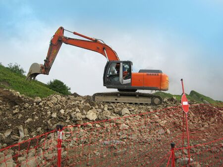 Excavator for road construction photo