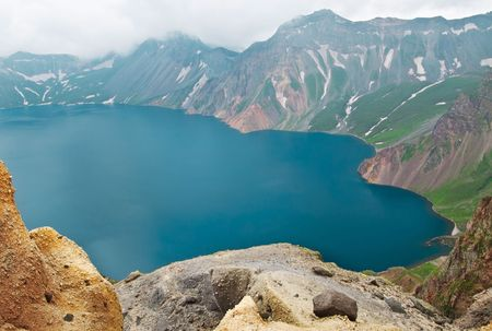 enviromental: Volcanic rocky mountains and lake Tianchi, wild landscape, national park Changbaishan, China Stock Photo