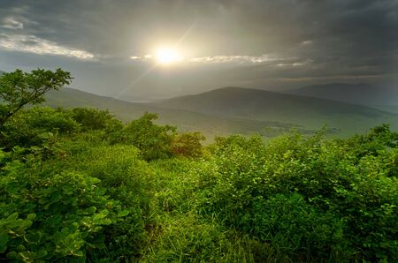 hdr: Sunset over green hills, Primorye, Russia, wild landscape Stock Photo