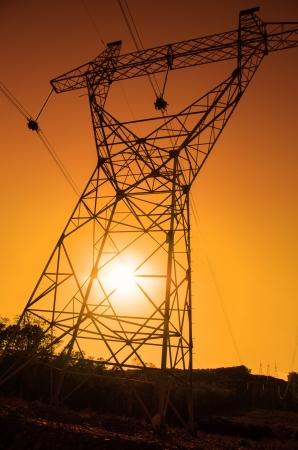 pylon: Electric pylon, energy power, sunset Stock Photo
