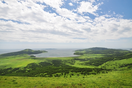 Green hills and blue sky, panorama  landscape of Khasan, Furungelma island, Primorye, Russia photo