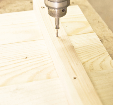tightening: Working with a drill, tightening screws, wood work